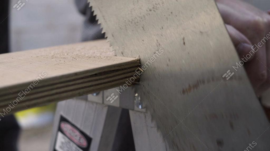 Hand Saw Cutting Wood Closeup Stock Video Footage 10194690