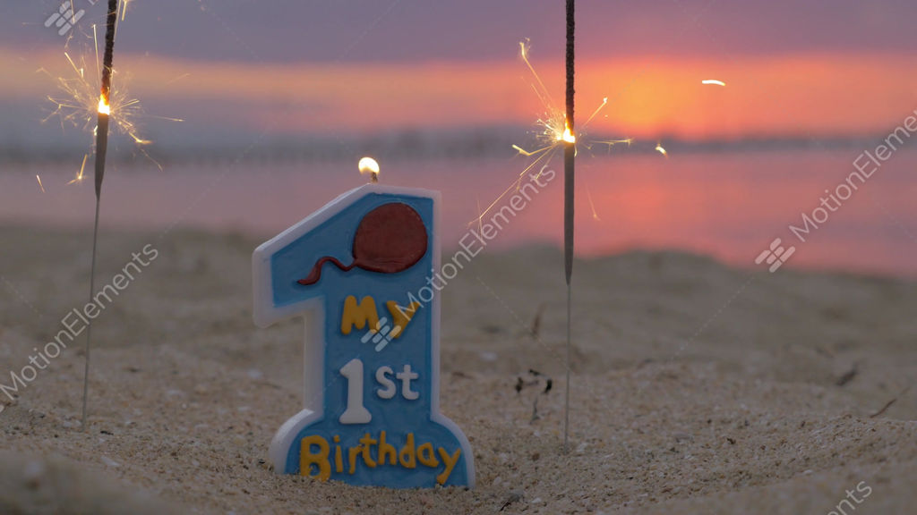 One Year Old Baby Boy Birthday Candle On The Beach Stock Video Footage