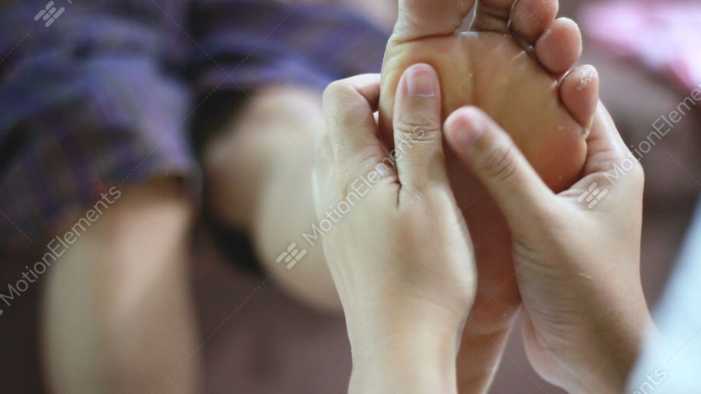 Hands Of Young Woman Gently Touch Massage To Foot Of Old Stock Video Footage