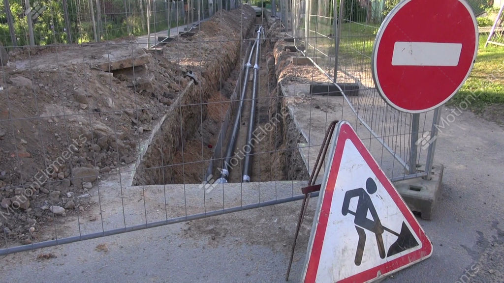 New heating system pipes in trench and road signs stock for New heating system