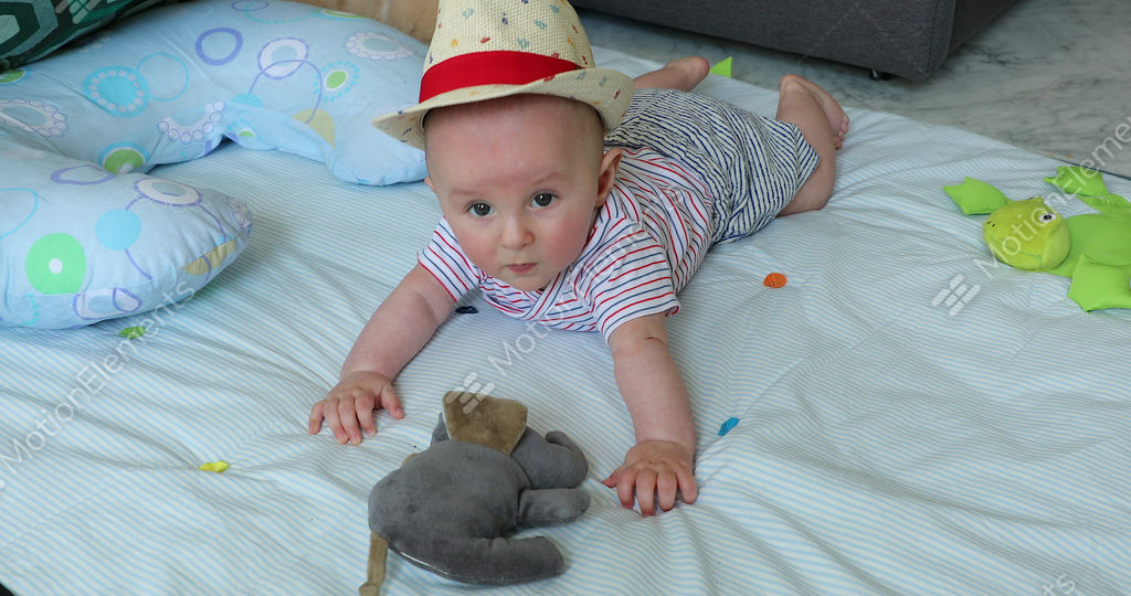 Cute 5 Month Old Baby Boy With His Straw Hat On A Play Mat Stock Video aeb7e892539