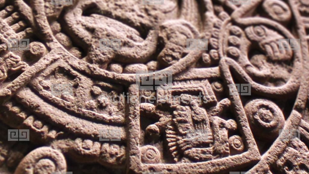 Pan over aztec sun stone carving stock video footage 9229040