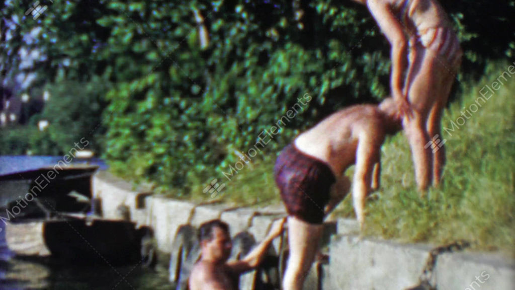 1963: hairy old men climbing out of thames river after a smelly swim