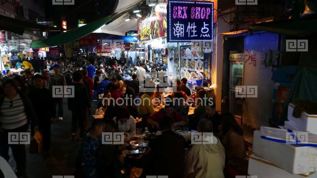 Chinese Sex Shop Sign On Crowded Night Street Open Air Stock Video