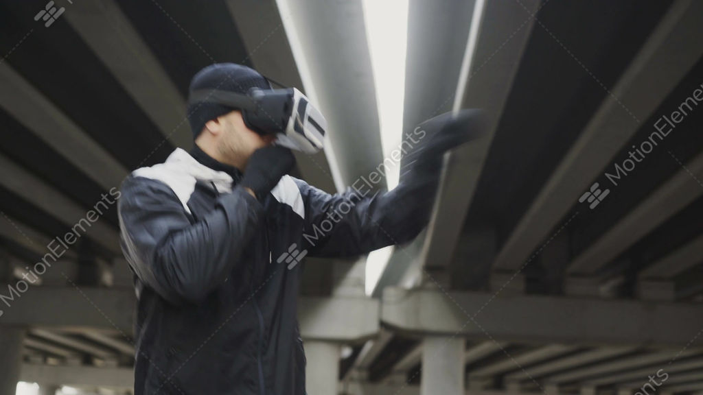2a6a9f3c8f99 Martial boxing man in VR 360 headset training punches in... Stock Video  Footage
