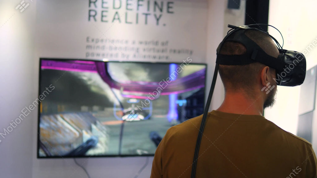 8b2e792e92db Young Man Playing Virtual Reality Games in VR Glasses... Stock Video Footage