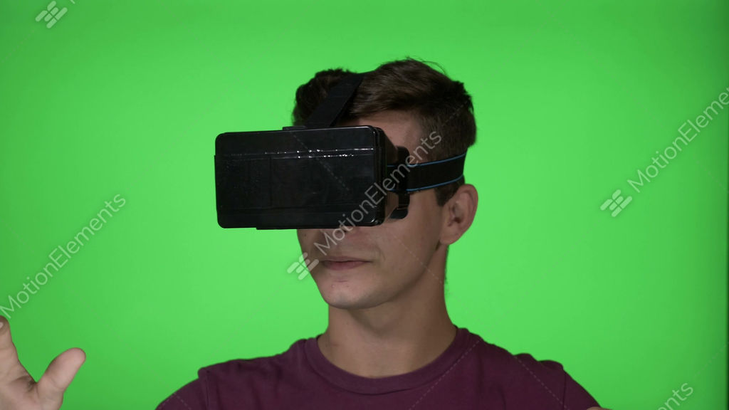 737cf295c514 Young man playing a horror adventure game using a VR... Stock Video Footage