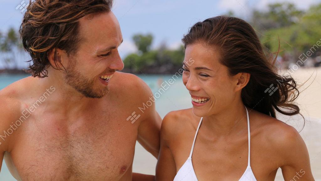 Sexy suntan interracial couple walking on beach during... Stock Video  Footage