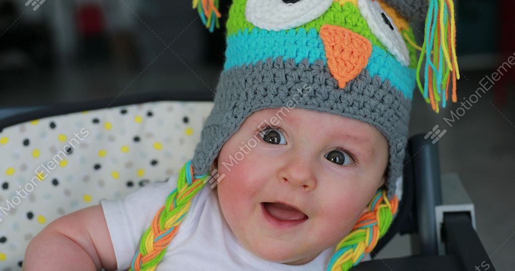 Cute Baby Boy With A Funny Wool Hat On The Head Stock video footage ... 16c27bb78ed