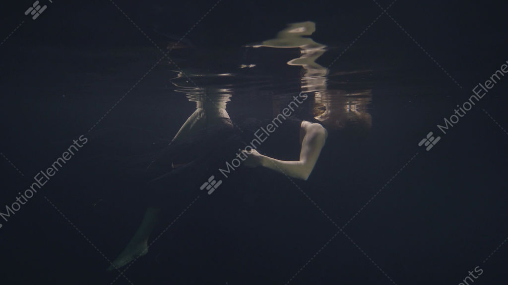 8c51af846d Young woman in black dress swimming underwater in pool... Stock Video  Footage