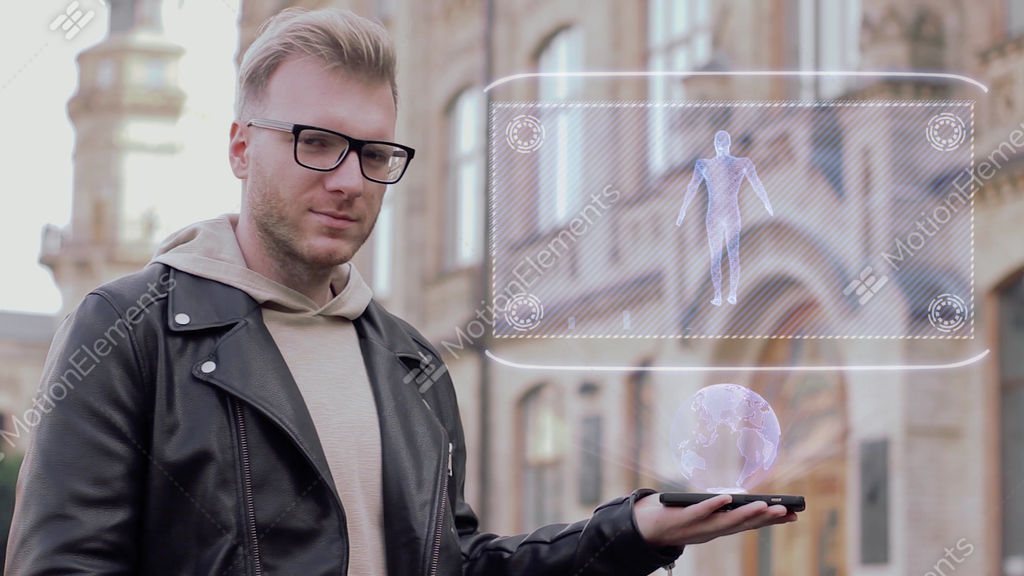 Smart Young Man Shows Hologram Body Particles Stock video footage