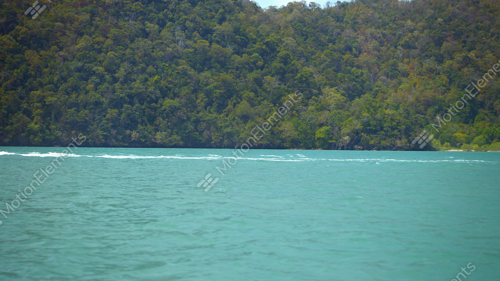 Fishing Boat Passing A Forested Tropical Island In Timelapse Stock Video Footage