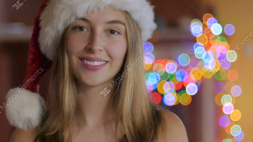 cbe49d2a920f5 A pretty young woman wearing a Santa hat blowing a kiss... Stock Video  Footage