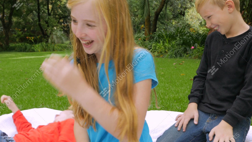 A Younger Brother And Older Sister Wrestle Playfully And Stock Video Footage
