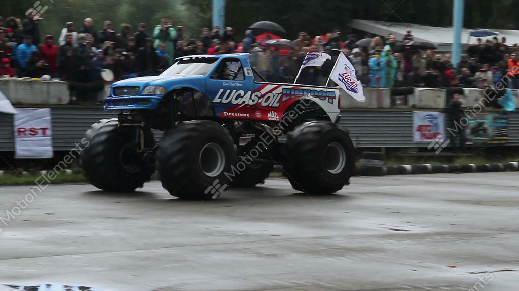 Huge Monster Truck Circling At Arena Crushing Junk Cars Show Stock - Monster car show