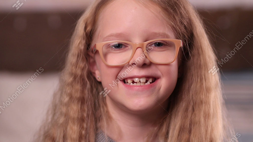 26ca583d24a1 Cute Little Girl In Glasses Smiling Stock video footage