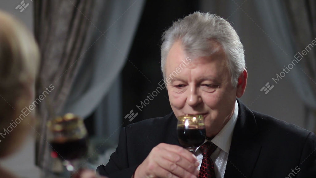 223ad32e4e19 Mature Man Drinking Glass Of Red Wine Stock video footage | 9699811